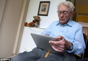 elderly man reading tablet